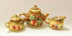 1:12th scale miniature tea set with fruit design and gold decoration in the Royal Worcester style ... by miniature artist Miyuki Nagashima