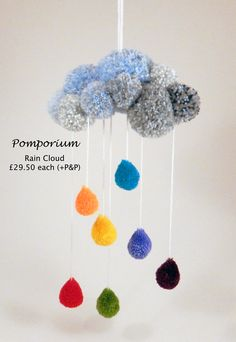 Pompom rain cloud with bright rainbow droplets. Can be made to any colour requirements. Find us on Facebook @ Pomporium to order.