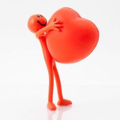 Bendy smile person with a red heart shaped stress ball