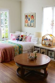 great idea for a kid's room.....coffee table with ottomans....they're always wanting a pint sized place to build legos, paint, draw, play