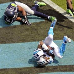Carolina Panthers' Steve Smith (89) catches a touchdown pass against Seattle Seahawks' K.J. Wright (50) during the first half of an NFL foot...