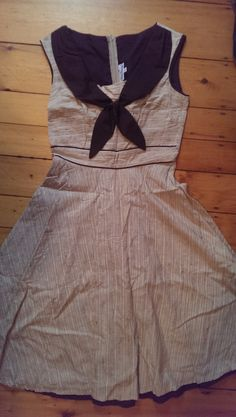 SWAPPED NO LONGER AVAILABLE Stop Staring! size L beige sailor dress. Textured with different colors of tan and brown lines. Wicked cute, but waist fits too tight. Might be more like a medium. Fabric gives no stretch. Limited swap as this dress was pricey brand new and has been worn practically never.