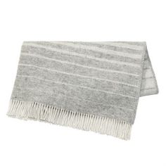 Keep yourself warm with Fade throw from the Swedish brand Nordic Nest. The throw is made of high quality lambs wool with a pattern inspired by a dark, quiet forest pond where the twilight's last reflection of the sun creates patterns on the surface. The throw has a timeless and simple design that looks great in virtually any home and is easy to mix and match with other textiles! Choose from different colors.