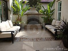 Outdoor Patio and Fireplace by Starletdarlene, via Dreamstime