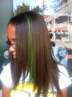 Add a splash of color with a clip on hair piece.