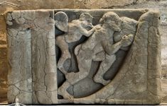 Punishment of Sisyphus. Sandstone. Metope from the temple of Hera at the mouth of the river Sele. Mid-6th century B.C.Paestum, National Archaeological Museum.