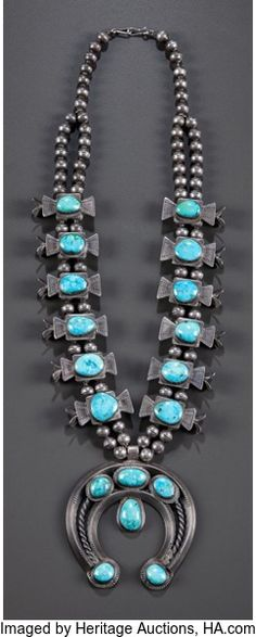 American Indian Art:Jewelry and Silverwork, A NAVAJO SILVER AND TURQUOISE SQUASH BLOSSOM NECKLACE. c. 1950...