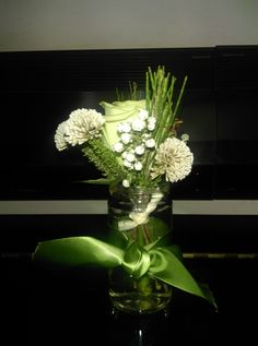 Small arrangement in bottle with single white rose and african mix
