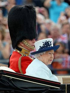 The Queen and Prince Philip in a horse drawn carriage at Trooping The Colour today in London. June 14, 2014.