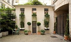 Parisian Courtyard... window basket architecture by M.A.M.