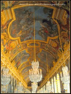 """Enjoy the murals on the ceiling of the Hall of Mirrors in the palace of Versailles, Paris.  Find out more at """"Down the Wrabbit Hole - The Travel Bucket List"""". Click the image for the blog post."""