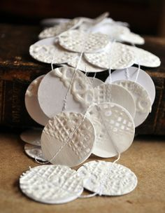 Paste paper doilies onto cardstock. Then punch into circles & sew a garland.