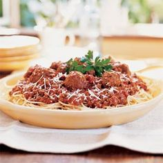 Porcini Meat Sauce -- Dried porcini mushrooms give this traditional spaghetti sauce a great earthy flavor. Makes enough to feed a crowd.