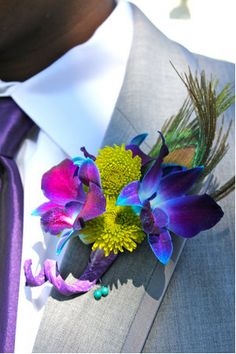 peacock wedding flower boutonniere, groom boutonniere, groom flowers, add pic source on comment and we will update it. can create this beautiful wedding flower look. Peacock Wedding Colors, Summer Wedding Colors, Wedding Flowers, Peacock Colors, Peacock Themed Wedding, Peacock Wedding Decorations, Peacock Cake, Vibrant Colors, Flower Colors
