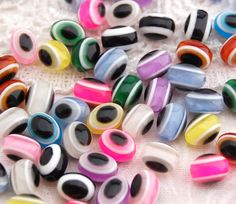 25 Mixed Multicolor Evil Eye Stripe OVAL Resin Beads by SmartParts, $1.99