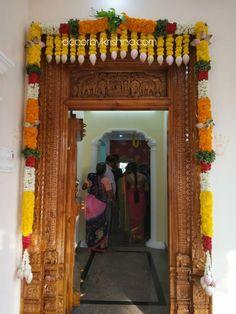 Decor by Krishna AP/ Telangana/ Karnataka/ Tamilnadu/ USA/Australia Main Entrance Door Design, Wooden Front Door Design, Home Entrance Decor, Door Flower Decoration, Flower Decorations, House Arch Design, House Warming Ceremony, Diwali Decorations At Home, Housewarming Decorations