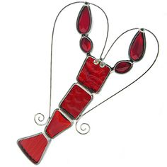 Lobster Heart Suncatcher. Contemporary sun catchers add instant color and cheer to any room! Handcrafted in the USA, this colorful crustacean features a variety of red art glass segments framed in sturdy lead-free metal. Eyes of crystal and lead-free heart-shaped wirework antenna provide the perfect accents! Includes an optional suction-cup hanger that attaches to any window or glass surface (but may also be hung with wire to decorate other areas).