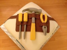 Just for the men - tool belt cake with hammer pliers and screwdrivers