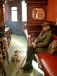 "menandtheirdogs:    jjones186: ""The bond with a true dog is as lasting as the ties of this earth will ever be.""    Ryan's Pub, Dublin, Ireland"