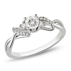 3/8 CT. T.W. Diamond Bow Engagement Ring in 10K White Gold - Zales    oh my word im in awe