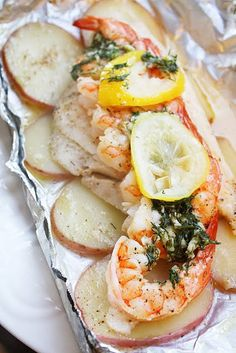 red potatoes,  white fish, shrimp, salt, pepper, fresh lemon juice, and a few dollops of butter mixed with fresh dill and garlic. Top it with a lemon slice, and grill for about 12 minutes