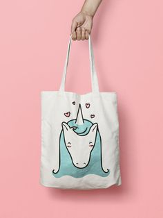 "Unicorn Tote Bag Canvas Funny Totes    This unicorn Tote bag is that universal product that everyone needs and uses.   A book bag, a grocery bag, or just somewhere to throw in all of those little everyday items.  100% Bull Denim Woven Cotton construction Dimensions: 14 3/8"" x 14"" (36.5cm x 35.6cm) Dual handles Fabric weight 11.0 oz/yd² (373 g/m²) Superior screen printing results A cute, all-purpose natural cotton Unicorn tote bag."