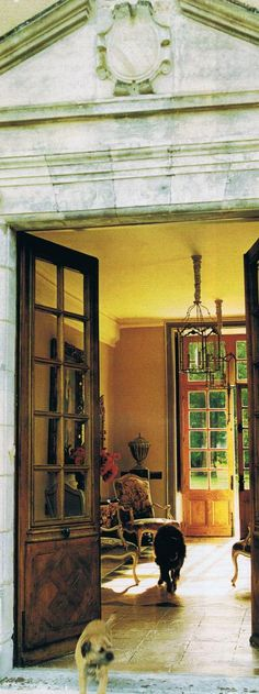 I love this English country entry....double French doors, beautiful yellow, stone floor....awesome
