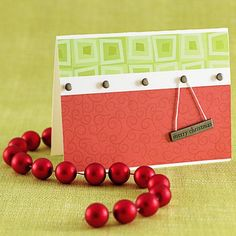Hanging Holiday Greeting Insert flat-top eyelets to the front of a Christmas card. Hang an engraved metal plaque with a holiday sentiment from one of the eyelets. Editor's Tip: Use a bit of double-stick adhesive to hold the plaque in place.