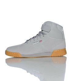 b600f51396 REEBOK High top men s sneaker Lace up closure with velcro strap Padded  tongue with REEBOK logo