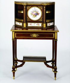 LavishShoestring.com |  Writing desk        Place of origin:        Paris, France (possibly, made)      Date:        ca. 1860 (made)      Artist/Maker:        Unknown (production)      Materials and Techniques:        Veneered in mahogany and light stained wood on pine, with painted porcelain, gilt-bronze and Bardiglietto marble