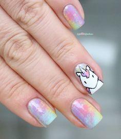 Rainbow and unicorn nail art.