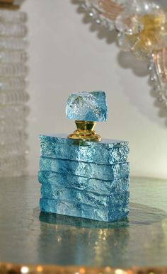 stunning light blue Liuli crystal perfume bottle with textured finish; With its … stunning light blue Liuli crystal perfume bottle with textured finish; With its unique look and style, this crystal perfume bottle is truly a work of art
