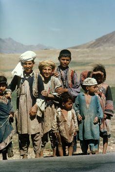 Farmers' children wait for school bus in rural Afghanistan.