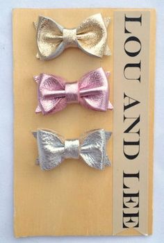 Itty bitty metallic leather baby bow set by louandlee on Etsy, $20.00