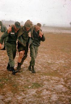 Two soldiers aiding an injured comrade, Vietnam.  #VietnamWarMemories