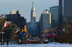 Ben Franklin Parkway with 109 flags from different countries, draped on either side of the boulevard. City Hall is seen at the end of the illustrious thoroughfare.