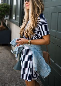 Striped dress, jean jacket around the waist, long loose curls