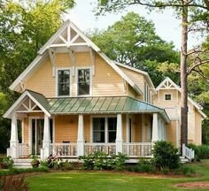 what colors go with a green metal roof | farmhouse exterior