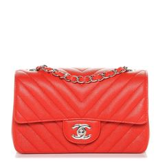 This is an authentic CHANEL Caviar Chevron Quilted Mini Rectangular Flap in Red. This chic mini cross body classic is crafted of caviar leather with a chevron quilting in red. The bag features a silver cross body shoulder chain threaded with red leather and a silver Chanel CC turn lock. This opens to a matching red leather interior with a zipper and patch pocket. This bag is ideal for any occasion, with the timeless style of Chanel!