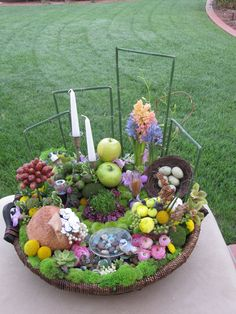 Persian New year arrangement in the basket Spring flowers with Haft Seen, By Roya Flowers