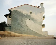 I adore this wave mural covering the entire side of the building. (Hossegor, France. Photograph by Ben Roberts).