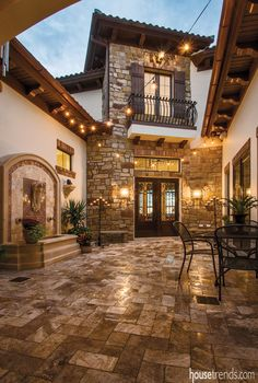 Globe lights over this home patio create a Tuscan-inspired getaway. See all our globe lights: http://www.lightsforalloccasions.com/c-245-globe-string-lights.aspx