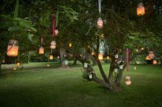 Light pathways to your marquee with tealights in the trees