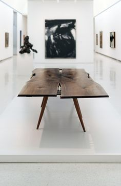 George Nakashima Table - beautiful contrast between the organic, solidity of the top and the delicate, simplicity of the base.