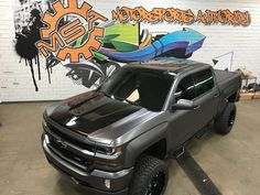 2016 Chevy Silverado wrapped in Satin charcoal wrap with gloss black hood center, roof, tailgate between taillights, and between two door glasses. Lifted Silverado, 2017 Chevrolet Silverado 1500, Lifted Chevy Trucks, Gm Trucks, Chevrolet Trucks, Pickup Trucks, 2016 Silverado, Chevy 1500, Chevy Vehicles