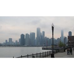 Mar 2012 Chicago, Illinois. Cloudy Chicago skyline from Navy Pier. ❤ liked on Polyvore featuring backgrounds