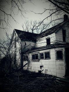 Abandoned forgotten farm house somewhere in Southeast Kansas