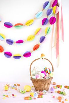 This honeycomb Easter egg garland is sure to brighten up any Easter dinner. Once you make all the eggs, assembling the garland goes very fast. If you wrap these carefully in tissue paper, and store th