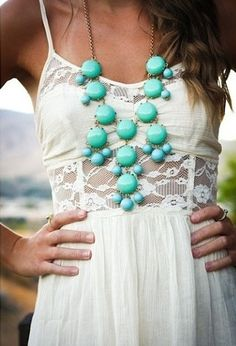 Cute outfit! Maybe a coral necklace.