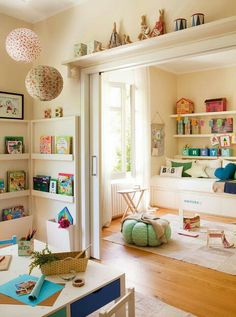 Love everything about this playroom.  It's light, airy, cheery, fun and calming all at the same time.